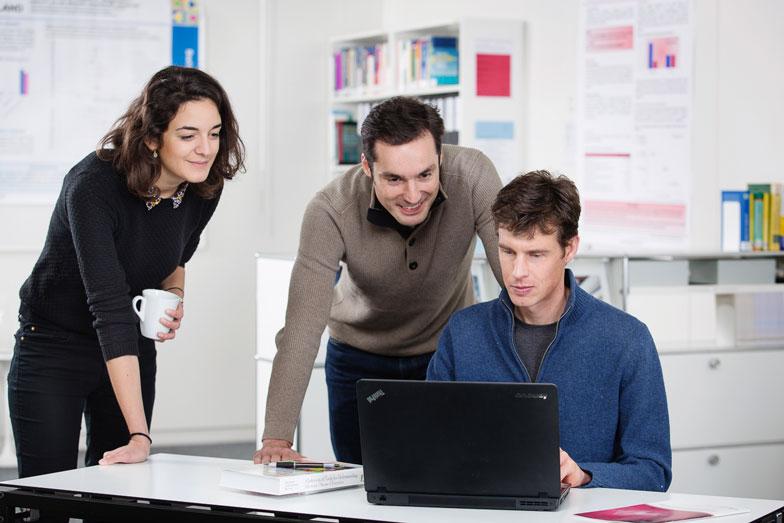 Research meeting around laptop