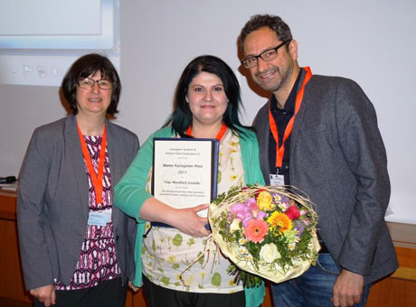 Myrofora Goutaki (centre) with the prize awarded by Katja Pier, member of the patients association management committee, and Professor Heymut Omran of the University of Münster, an expert on PCD and head of the GPP's PCD group.